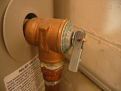temperature and pressure valve before reseating by a plumber in Gilbert arizona