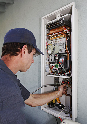 Gilbert plumbing professional maintains a tankless water heater
